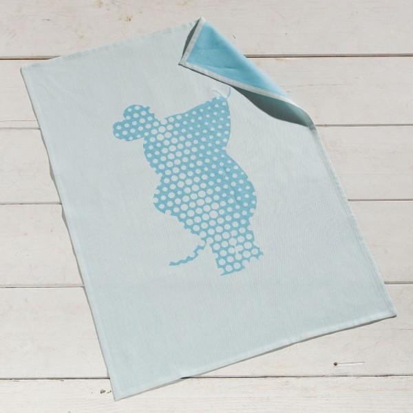 Geschirrtuch Nummer 1 mit der Maus blau auf dem Tisch