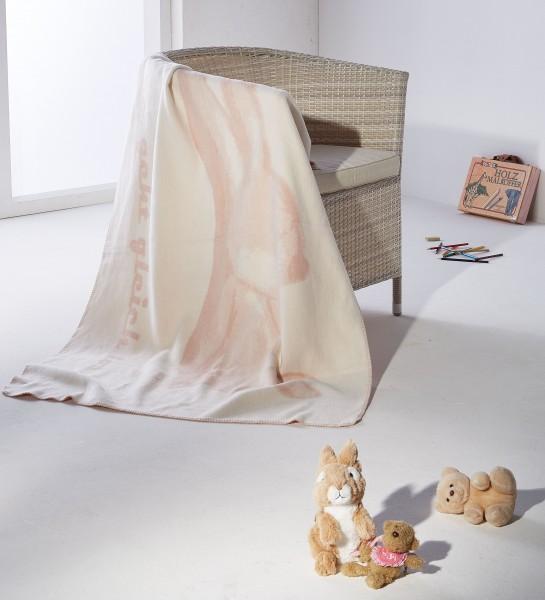 Hasenkolter rosa-weiss auf dem Sessel